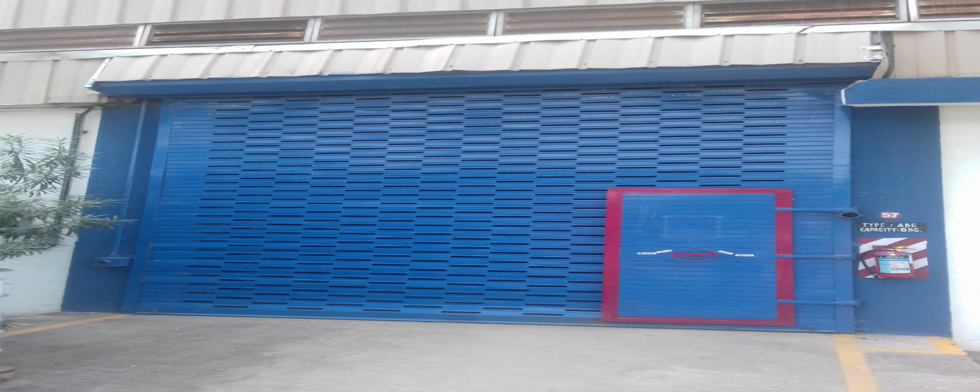 Galvanised perforated rolling shutter